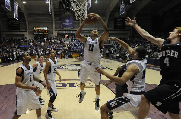 Northwestern's Reggie Hearn, middle, goes up for a rebound in the first half Saturday. (USA Today Sports Photo)