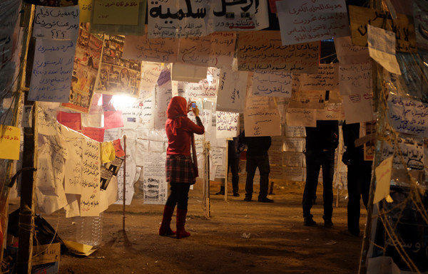 A woman visits an installation of political slogans in Cairo's Tahrir Square on Saturday.