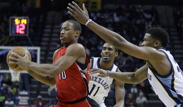Toronto's DeMar DeRozan, shown against Memphis' Mike Conley and Rudy Gay, leads the Raptors in scoring, averaging 18.1 points per game.