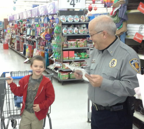 Detective John Emminizer shops with Caleb, 7, during the Westminster Police Department's Shop With a Cop event on Dec. 8.