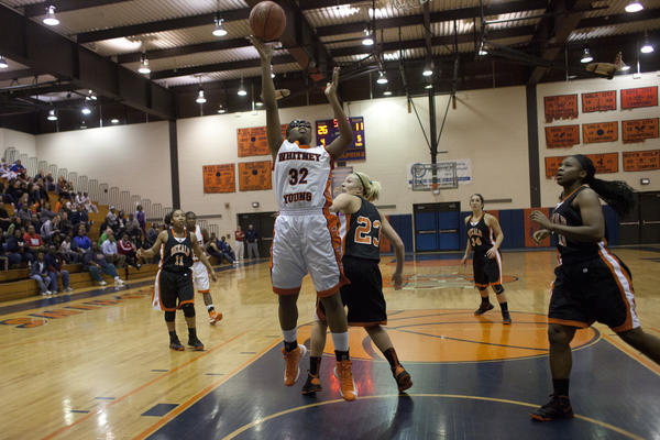 Whitney Young junior Taylor Brame goes up for a lay-in.