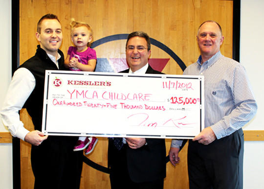 Kessler's recently donated $125,000 to the Y Youth Development Center being constructed west of the Aberdeen Family YMCA on South State Street. From left are: Reed Kessler and his daughter, Eleanor Kessler, Robert Fouberg and Steve Graf. Reed is the executive vice president of Kessler¿s, Fouberg is spearheading the fundraising efforts for the new childcare facility, and Graf is the executive director of the YMCA.