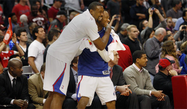 DeAndre Jordan, left, and Willie Green cheer on the bench players as the Clippers pull away in the fourth quarter to beat the Phoenix Suns, 117-99, Saturday at Staples Center.