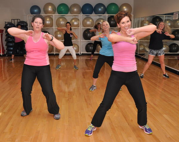 Niki Zikmund and Jennifer Waddle, front row, along with Nichele Canavan, Heather Grebner and Jenna Berdt exercise in the zumba class at the Aberdeen Family YMCA. Nutrition experts say it¿s better to maintain weight through the holidays, and exercise can help.