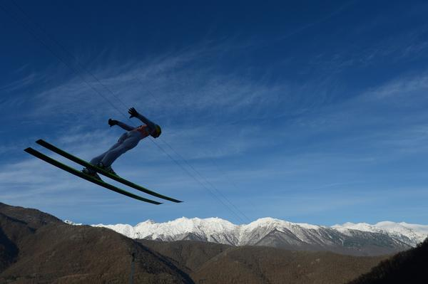 A skier jumps during the men's normal hill individual at the FIS Ski Jumping World Cup tournament in Sochi on December 9, 2012.