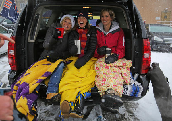 Bears fans tailgating in the snow before the game.