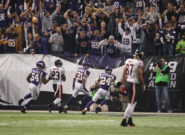 Vikings cornerback Josh Robinson celebrates his interception during the first half.