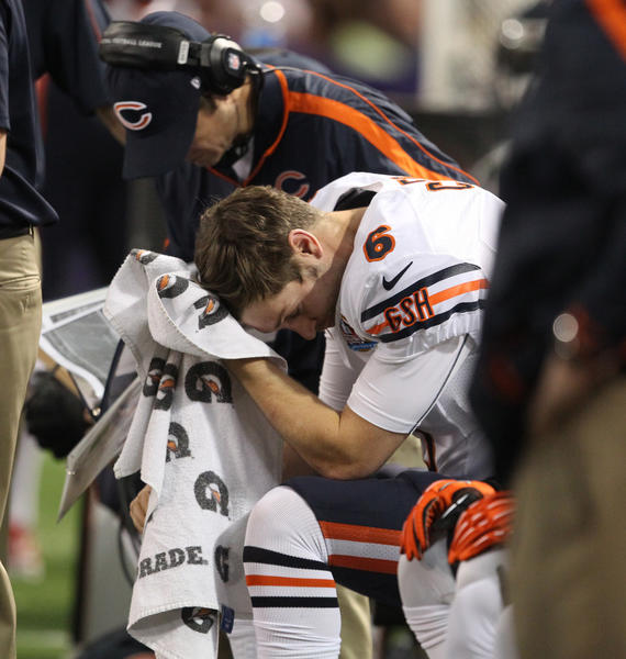 Quarterback Jay Cutler wipes his face with a towel after he threw an interception to Vikings cornerback Josh Robinson.