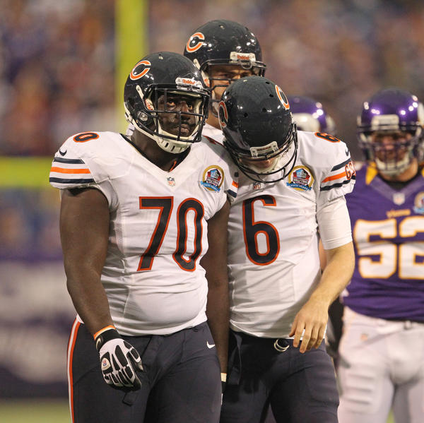 Down 14 points, Edwin Williams and Jay Cutler look dejected after a timeout during the first quarter.