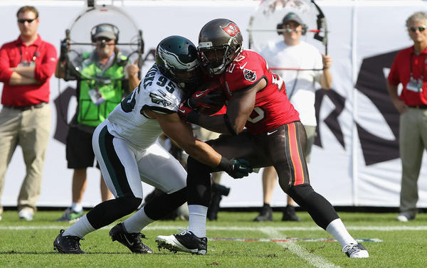 Philadelphia Eagles outside linebacker Mychal Kendricks (95) tackles Tampa Bay Buccaneers running back D.J. Ware (28) during the first half at Raymond James Stadium.