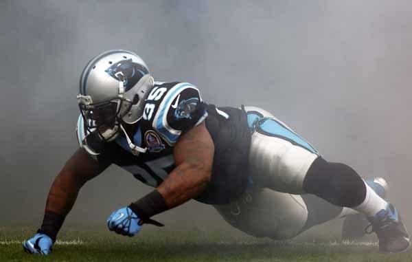 Carolina Panthers running back Armond Smith crawls out of the tunnel as he is introduced against the Atlanta Falcons during the first half of their NFL football game in Charlotte.