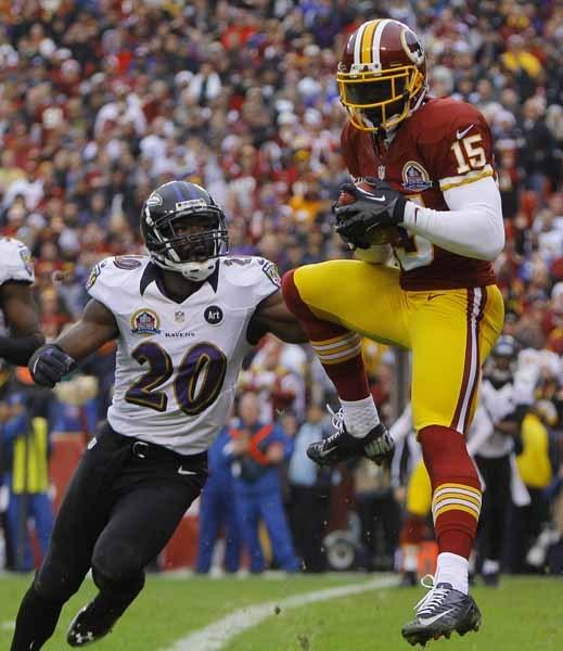 Washington Redskins receiver Morgan catches touchdown pass against Baltimore Ravens safety Ed Reed during their NFL football game in Landover Maryland.