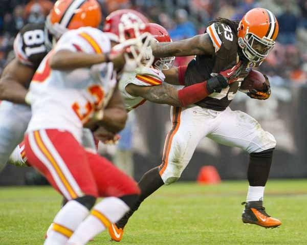Cleveland Browns running back Trent Richardson runs for a gain during the second half against the Kansas City Chiefs at Cleveland Browns Stadium.