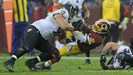 Robert Griffin III, the Redskins' sensational rookie quarterback, sprained his right knee in the fourth quarter Sunday.