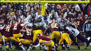 The player that the Ravens spent all week trying to devise a way to contain was finally stopped. Robert Griffin III wasn't on the field after the Washington Redskins' rookie took one more punishing hit in an afternoon filled with them, the last by Ravens defensive tackle Haloti Ngata, injuring Griffin's knee and knocking him out of the game.