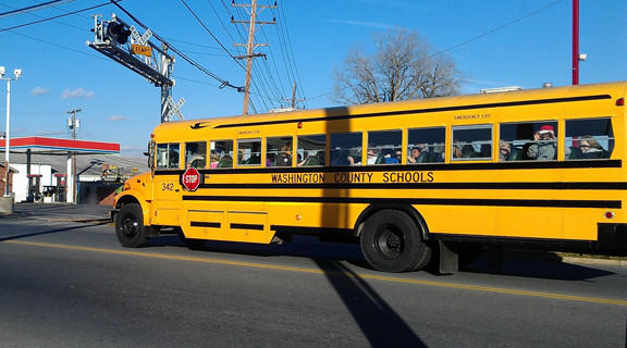 "A Washington County school bus stops at a railroad crossing with an ""exempt"" sign on Frederick Street in Hagerstown last week."