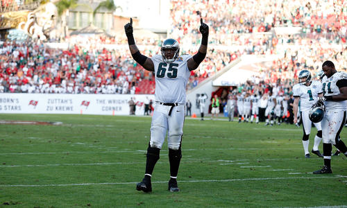 Left tackle King Dunlap #65 of the Philadelphia Eagles celebrates the winning touchdown against the Tampa Bay Buccaneers during the game at Raymond James Stadium on December 9, 2012 in Tampa, Florida.