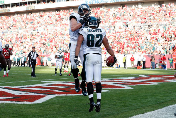 Tight end Clay Harbor #82 of the Philadelphia Eagles celebrates his touchdown with Riley Cooper #14 against the Tampa Bay Buccaneers during the game at Raymond James Stadium on December 9, 2012 in Tampa, Florida.