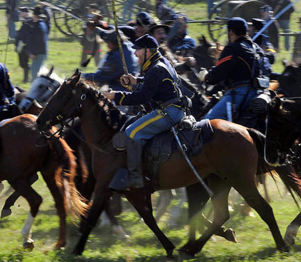 Union Cavalry soldiers have sabers at the ready during the Battle of Antietam at the Antietam 150th Anniversary re-enactment site in September. The battlefield had a major spike due to the sesquicentennial, including about 50,000 people visiting the battlefield the weekend leading up to the anniversary.