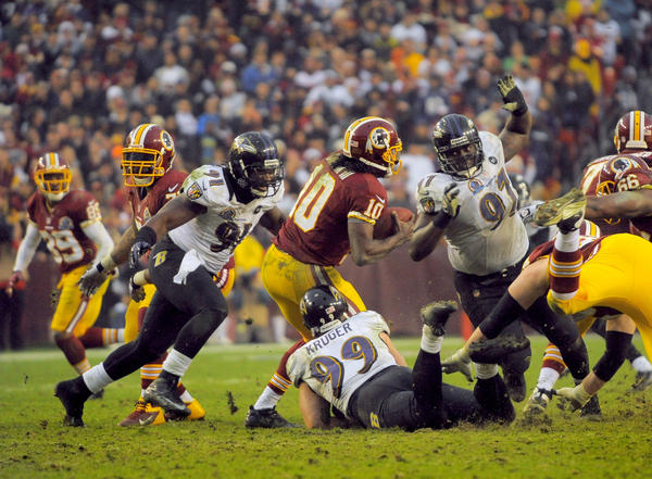 Redskins quarterback Robert Griffin III sacked. he would later leave the game with a knee injury, but Redskins would win 31-28 in overtime.