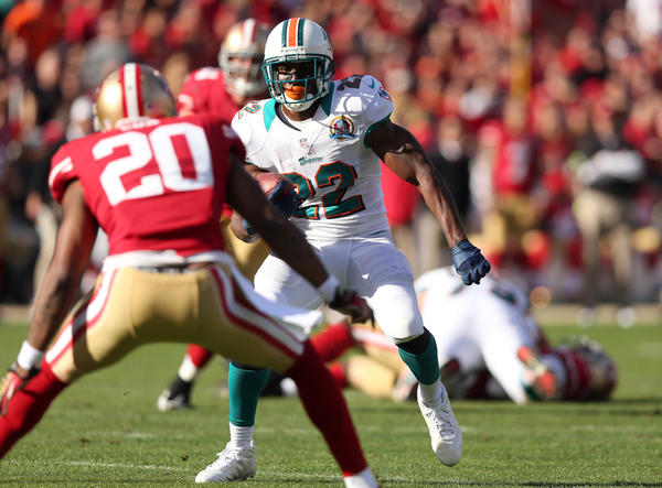 Reggie Bush #22 of the Miami Dolphins runs with the ball during their game against the San Francisco 49ers at Candlestick Park on December 9, 2012 in San Francisco, California. San Francisco won 27–13.
