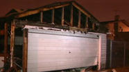 One of the garages damaged by apparent arson fires in the Belmont-Central neighborhood early today. WGN-TV