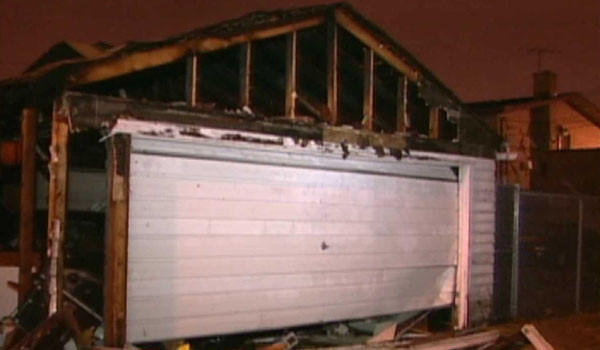 One of the garages damaged by apparent arson fires in the Belmont-Central neighborhood early today.