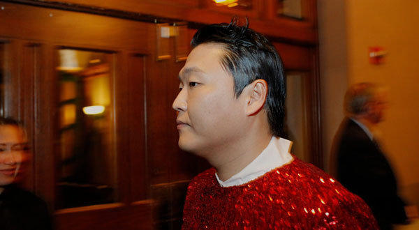 South Korean rap star Psy walks backstage before performing at the annual Christmas in Washington charity concert.