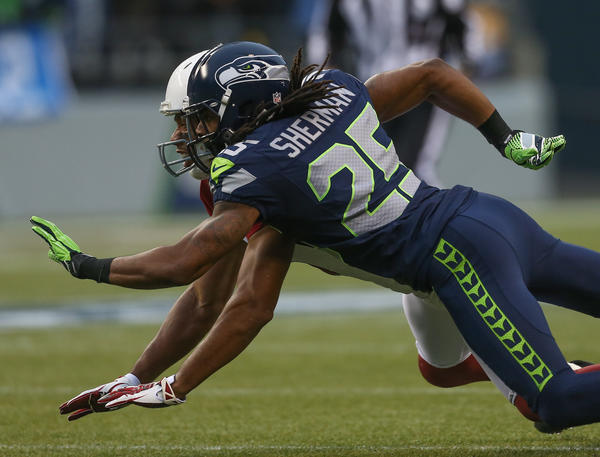 Cornerback Richard Sherman #25 of the Seattle Seahawks defends on a pass intended for wide receiver Larry Fitzgerald #11 of the Arizona Cardinals at CenturyLink Field on December 9, 2012 in Seattle, Washington. Seattle won 58–0.