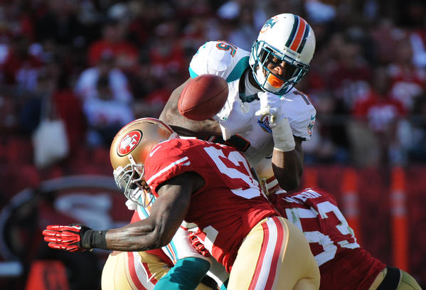 Davone Bess gets hit by Patrick Willis and fumbles but the Dolphins recovered in the third quarter.