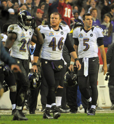 Safety Ed Reed, long snapper Morgan Cox and quarterback Joe Flacco head to the locker room after the Ravens' loss to the Redskins.