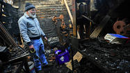 Dan Tokar was poring through the charred ruins of what was once the forge room of Willow Forge, his blacksmith shop on South Princess Street, before it was destroyed in a fire Nov. 30.