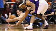 Orlando's J.J. Redick and Phoenix's Jared Dudley battle for a loose ball during the Magic's win Sunday. Christian Petersen, Getty Images.