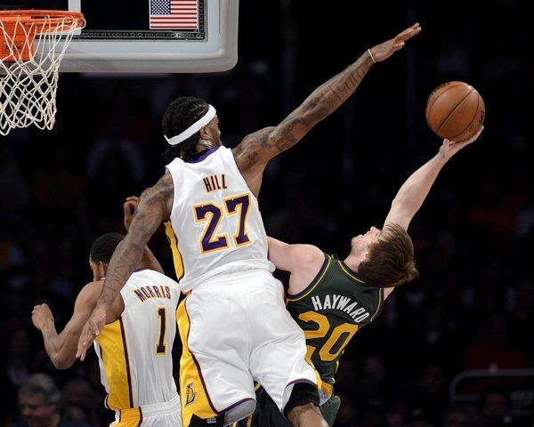 Reserve big man Jordan Hill blocks a shot by Utah forward Gordon Hayward.