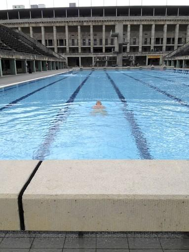 A swimmer takes a dip at Berlin's Olympic Stadium.