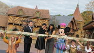"From left, Walt Disney Parks and Resorts Chairman Tom Staggs, Ginnifer Goodwin (Snow White, ABC's ""Once Upon a Time""), pop star Jordin Sparks and Mickey Mouse cut the ribbon to officially open New Fantasyland at Walt Disney World's Magic Kingdom."