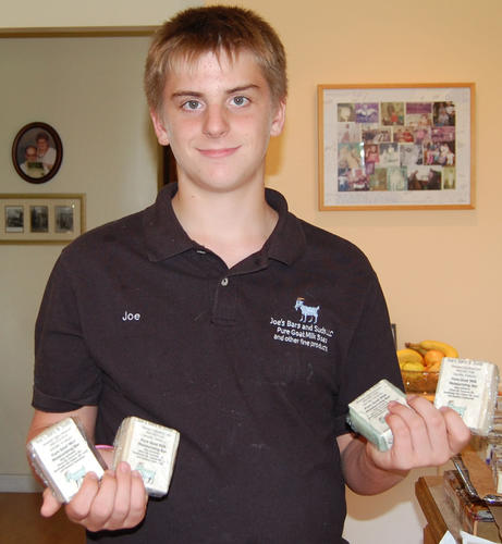 Bremer holding some of the various soaps he makes and sells.