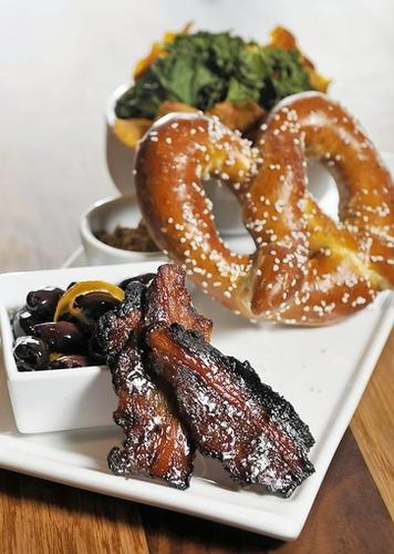 """Bar Bites"" at Barley Vine in Bristol include the house-made praline bacon, orange-marinated olives, house-made pretzel with IPA mustard and kale and sweet potato chips with smoked sea salt."