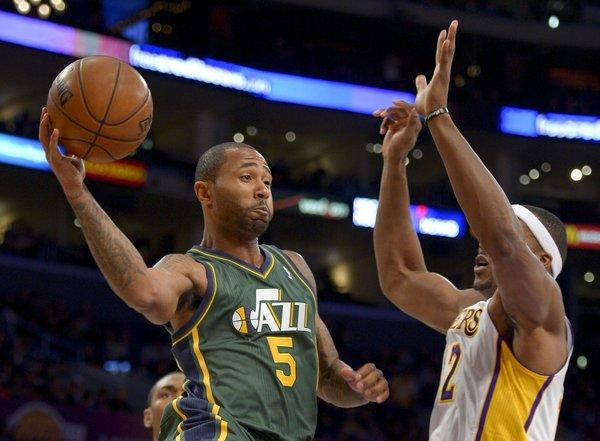 Utah Jazz guard Mo Williams passes around Lakers center Dwight Howard