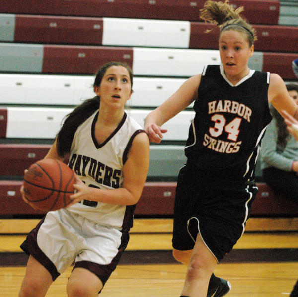 Charlevoix senior guard Sydney Carlson (left) pulls up for a shot as Harbor Springs senior Mallori Keller defends Friday at the Charlevoix High School gym. The Rayders defeated the Rams, 59-48.