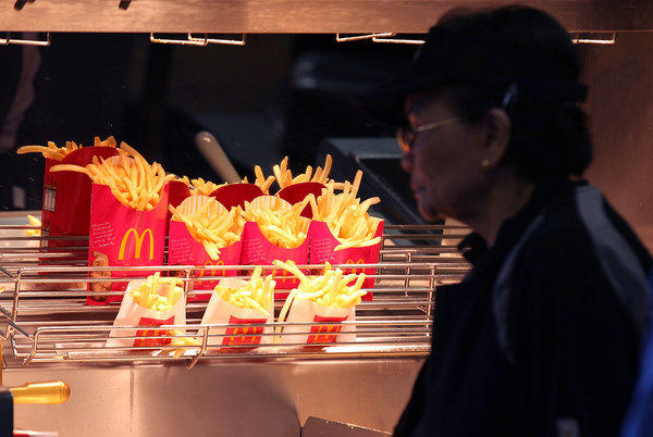 French fries sit under a heat lamp at a McDonald's restaurant in San Francisco.