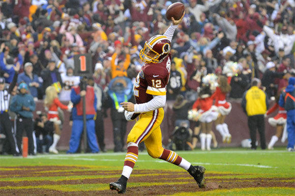 Washington quarterback Kirk Cousins celebrates a two-point conversion to tie the game with Baltimore at 28-28.