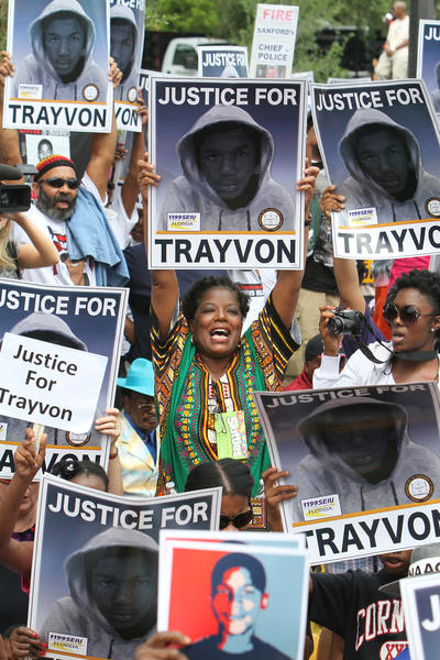 Thousands of demonstrators come together in front of the Sanford Police Department during a NAACP rally and march demanding for justice in the shooting of Trayvon Martinin Sanford, Fla. Saturday, March 31, 2012.