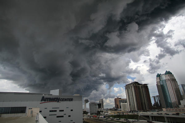 Storm clouds form over Amway Center the day Orlando Magic Rob Hennigan announced Dwight Howard was traded to the Los Angeles Lakers Friday, August 10, 2012.