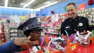 Police and youngsters share joy of giving at Shop with a Cop