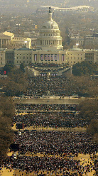 Crowds look towards the Capitol during the inauguration of Barack Obama as the 44th President of the United States of America on the National Mall January 20, 2009 in Washington, D.C.