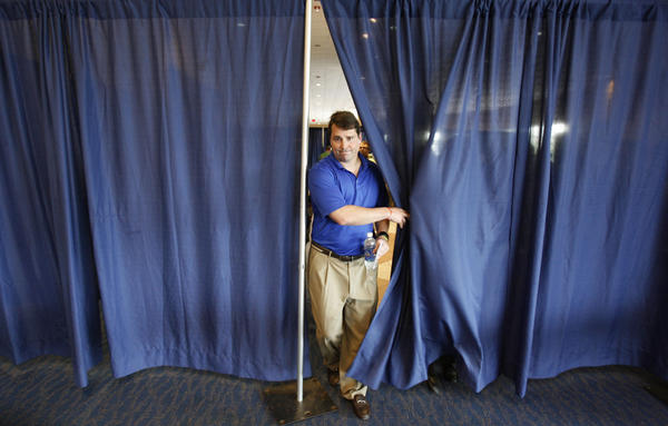 University of Florida head coach Will Muschamp leaves the podium after speaking during the Gators' annual media day in Gainesville, Fla. Thursday, August 2, 2012.