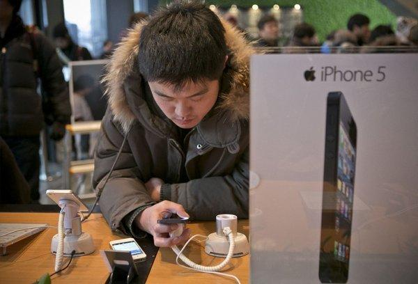 A customer examines the iPhone 5 in South Korea.