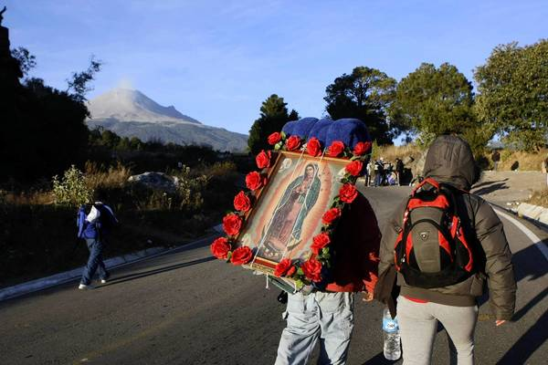 A pilgrim carries a picture of the Virgin of Guadalupe in Paso de Cortes, in the Mexican state of Puebla December 9, 2012. Millions of Mexican Catholics travel to Mexico City to celebrate the Virgin of Guadalupe Day on December 12.