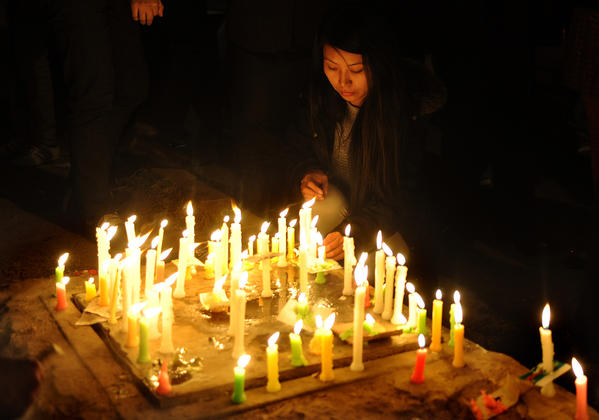 Tibetans living in-exile light candles as they take part in a candle light march in New Delhi on December 10, 2012 to mark World Human Rights Day. A 16-year-old Tibetan girl has died after setting herself on fire, Chinese state media said December 10, in an area that has become a flashpoint for protests against Beijing's rule.